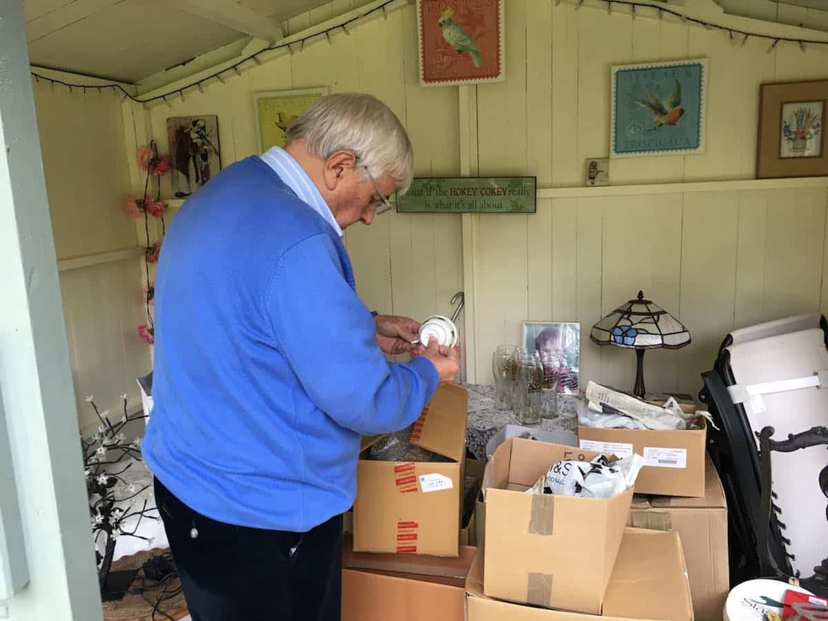 Christopher Garrett Ebay Entrepreneur Wirral - sorting through his colections in the shed Ukandoo Academy ebay Making Money from Ebay - Even in Retirement Christopher Garrett Ebay Entrepreneur Wirral sorting through his colections in the shed Ukandoo Academy